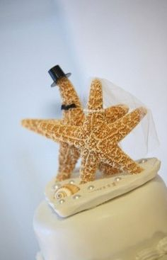 Starfish cake topper for a beach-themed wedding.