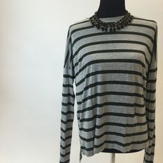 Vince Striped Top Absolutely scrumptious Vince striped top. Stripes are grey and hunter green and the material is so soft. Material is 100% viscose. Worn only once or twice. Vince Tops
