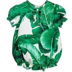 Green and ivory baby shortie by Dolce & Gabbana. Made in smooth cotton poplin, it has a beautiful banana leaf print, inspired by the Palermo Botanical Garden. The shortie has pretty puffed short sleeves with frilled cuffs and a ruffle detail down the front with decorative buttons. There is a concealed back zip fastening, elasticated frilled leg cuffs and poppers underneath for easy nappy changes.