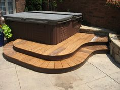 If you have either an above ground or in-ground pool, a professionally installed pool deck is critical. We specialize in gorgeous, affordable pool decks. Hot Tub Patio, Hot Tub Garden, Decking Fence, Hot Tub Surround, Deck Steps, Small Backyard Gardens, Brick Patios, Pool Decks, Planting Flowers