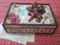 Uma adorável caixa para fotos.