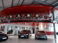 Joe Macari Ferrari Maserati Showroom using our Red and Black Lacquer Stretch Ceilings