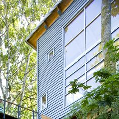 """Great Resource for """"Green"""" building materials, This is an example of Corrugated Steel use for home construction.  Re-use old shipping containers for home shape. Shipping container costs from $2000-$3000"""