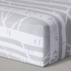 Gray Birch Fitted Crib Sheet from Cloud Island™. Bare birch trees climb across this crib sheet making it seem like baby is one with the trees while sleeping