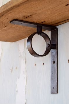 "Hand-hammered metal shelf bracket with blackened iron finish. Connected with hammered rivets for an industrial look. This shelf bracket measures 9 1/2"" x 7"" x 1 1/2"" We recommend a shelf bracket every"