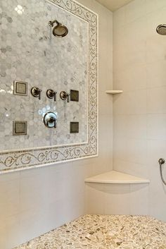 Incredible bathroom shower with calcutta marble, polished hexagonal tile with stunning mosaic vine border. Bathroom Remodel Shower, Shower Cabinets, Marble Showers, Master Bathroom Decor, Bathroom Interior, Bathroom Ornaments, Amazing Bathrooms, Calcutta Marble, Bathroom Shower