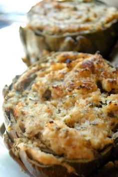 """Substitute our Three Cheese Seasoned Sourdough Nibblers instead of breadcrumbs. """"Stuffed Artichokes with Ricotta, Parmesan, Garlic, Lemon, and Breadcrumbs. I Love Food, Good Food, Yummy Food, Tasty, Great Recipes, Favorite Recipes, Vegetarian Recipes, Cooking Recipes, Cooking Ham"""