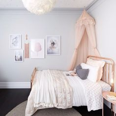 No words @ronnieandgeorgia. This is the most stunning girly girl room we've ever seen! Pinks and greys are the perfect colour palette for a little lady's room. And that art wall! #theblockshop #9theblock #kidsroom #kidsdecor