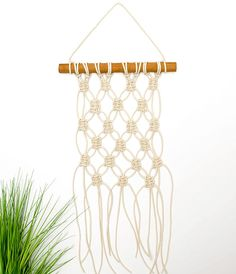 Have you ever wanted to try your hand at macrame only to be deterred by all those intricately detailed knots? Then you will love today's DIY mini macrame wall hanging tutorial. Using just one knot you'll be able to create this beautiful diamond-shaped pattern in under an hour. I am not kidding – it's that easy. Once you get the hang of this one knot, then you will want to try your hand at another, and another, and another. It's that addictive. But before we get carried away with ourselves…