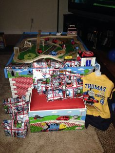 Thomas Train Table from Learning Curve with Christmas gifts wrapped in Thomas gift wrap...it was a very Thomas Christmas!