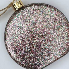 CHARLOTTE OLYMPIA Perspex Glitter Bauble Clutch This is a new in box Charlotte Olympia Multicolored Perspex (lucite) Glitter Bauble Clutch Handbag. This designer clutch is decorated with glitter,and is the ultimate attention-grabber! This is a glitz and glamour holiday look. An ornament! Personally, This fancy wristlet can really jazz up a simple look. Charlotte Olympia Bags