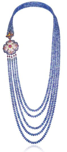 Red Carpet necklace in 18ct white gold and titanium set with tanzanite beads (843cts), mutlicolored sapphires (8.5cts), amethysts (7.6cts), rubies (5cts), Paraiba tourmalines (3.9cts) and tanzanites