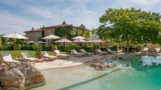 The Borgo swimming pool provides a view over the hills of Tuscany