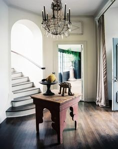 Design Ideas: Foyer With A Vintage Chandelier. reclaimed wooden table. wood flooring. vintage chandelier.
