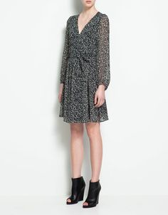 I love these sorts of dresses. Printed but not overwhelming, long enough not to be too fancy, feminine and draped and YUM. $59 at Zara Canada