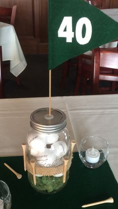 Golf theme centerpieces for 40th birthday party. Tees, flag and balls on turf by Olives Events, Princeton, NJ. Use foam circles from the dollar store as the golf balls. Write their favorite brand on them.