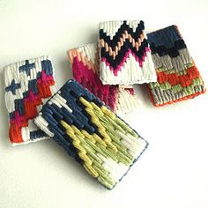 A Alicia tapestry brooches.