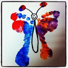 Kids paint on blank canvas. Butterfly feet.