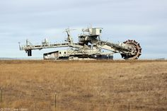 Alongside Bishop Road, a retired bucket-wheel excavator is parked between Belle Ayr Mine and Caballo Mines