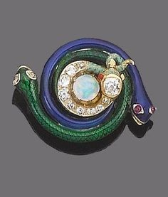 A late 19th century enamel, opal and diamond brooch. The green enamel snake with rose-cut diamonds eyes, entwined with a blue enamel snake with cabochon ruby eyes, to a central pale green snake set with old brilliant-cut diamonds and encircling a cabochon opal.