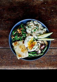 Soft Boiled Egg and Fried Halloumi with Couscous, Avocado, Fried Mushroom, Asparagus, Spinach, Pumpkin Seeds and Mint