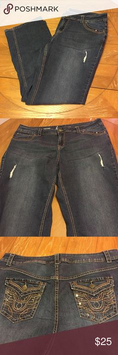 """🎡Lane Bryant stretch slim boot cut jeans 20/22 Stretch jeans from Lane Bryant in slim boot style. No tag but these are either a women's size 20 or 22. Measures about 20.5"""" across the top of waistband when laying flat and unstretched. Stretches easily to 23"""". Inseam is 31.5"""". Front rise about 10.5"""" and rear rise 18"""". Dark rinse with very light whiskering, silver & pewter stitching throughout, 2 distress spots with backing on the inside. Button flap back pockets are embroidered and have some…"""