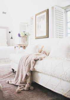 Traditional sofa and fun blanket: http://www.stylemepretty.com/living/2015/08/05/soft-luxurious-los-angeles-home-tour/ | Photography: Tessa Neustadt - http://tessaneustadt.com/