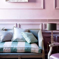 Pink wall and striped silk couch