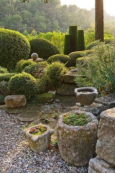 Provençal garden by Nicole de Vesian  Find your dream #StonePlanters for your garden at www.exceptionalstone.com/product-category/patio-and-landscaping/stone-garden-planters/