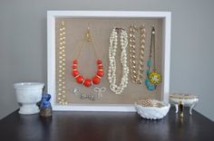 Great way to use a shadowbox with pins to display jewelry so you can see all the great stuff you have & wear it more often!