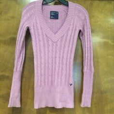 American Eagle lilac cable knit sweater This sweater has a plunging v neck, and a long, form fitting shape. The color is a soft lilac/pink. Excellent condition. I included a picture of a picture of me wearing it, because I can't model it for you right now (32 weeks pregnant!). American Eagle Outfitters Sweaters V-Necks