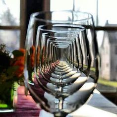 Cool photography idea. Pretty easy to recreate.. you need alot of glasses! :)