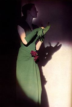 Classic 1940s style accentuated by shadows and light. #vintage #fashion #1940s #green #dress #gloves