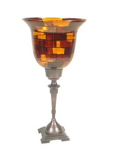 16 Inch Glass Candle Holders (set Of 2) by Backyard Bargain. $19.99. Multi colored shades of amber stains.. Standing 16 Inch tall with hand painted detail.. Classic lines on the bronze metal finish.. Simply, elegantly gorgeous - what else can you say? Standing 16 Inch tall with hand painted detail, multi colored shades of amber stains and classic lines on the bronze metal finish - no one will question your taste. Order three of these hand made candleholders for a fabulous cente...