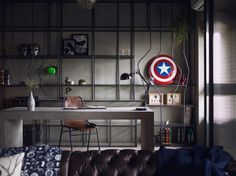 home office with gray desk and leather chair  decorated by Captain America's sheild and Iron Man's masks