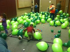 Doing an indoor Easter Egg hunt with balloons to hide them under ...