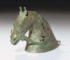 A KHORASSAN BRONZE OPENWORK HORSE HEAD NORTH EAST IRAN, 13TH CENTURY