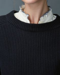 Classic, quite boxy, fisherman's rib sweater in a medium weight, soft and lofty wool. Double rib trim, boat-ish collar. Long raglan sleeves. Travelling rib detail at hem. Back sleeve is grown on, into yoke.