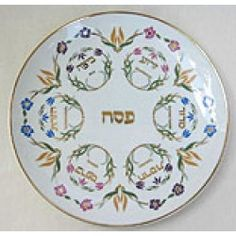 """This splendid ceramic seder plate will add a touch of grandeur to your Seder table! The exquisite plate features floral designs in soft pastel colors throughout. Six floral circles with Hebrew lettering inside indicate the placing of the ceremonial Seder items. Pesach is written in the center of the 10.25"""" plate.  Priced at $26.95"""