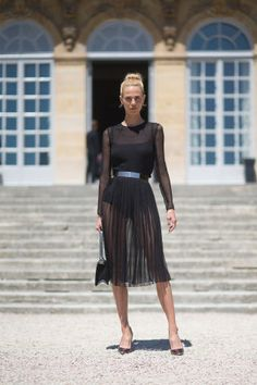 See all the chicest street style outfits spotted this week at Paris Couture Week.