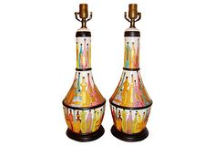 Pair of midcentury ceramic table lamps decorated with rows of brightly colored bottles. Lightly incised and hand-glazed with bands of black. Wired and in working condition. Uses standard bulbs.