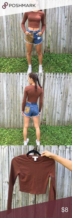 Basic Brown Long Sleeve Crop Top The perfect basic for any style wardrobe! Make room for this top in your closet, and you'll find it pairs nicely with many different shorts, skirts, and pants, and looks nice under many styles of outerwear. The stretchy cotton fabric is breathable and comfortable. Good color and style for all seasons. Forever 21 Tops Crop Tops