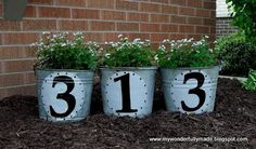MyWonderfullyMade.blogspot shows her house number buckets how she made em yard-art-gardens-porch