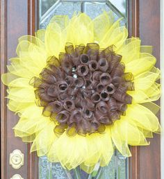 Beautiful yellow sunflower deco mesh door hanger. This gorgeous wreath measures approximately 22 across. It is perfect for sunflower lovers.