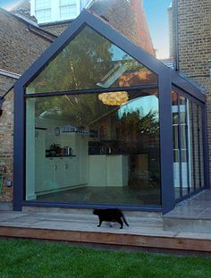 A small building extension project by Stephen Turvil Architects in Stradella Road, London Building Extension, House Extension Design, Glass Extension, Roof Extension, Extension Ideas, Modern Conservatory, Glass Conservatory, Conservatory Interiors, Bifold Doors Extension
