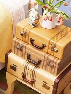 "For the vintage suitcases I have, another side table idea: ""For a dose of quirky charm, search flea markets for 3 suitcases in graduated sizes. Measure & cut a base from plywood to accommodate your largest case. Screw wooden furniture legs onto the base, paint, dry, & stack the suitcases on top. Use the suitcases to store off-season clothing & accessories."""
