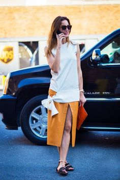 Look taller and longer by pairing your classic tops with a midi skirt with a slit