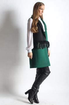 Black and green vest with feathers. Wear yours with a silky blouse and leather pants for a cool texture contrast. Green Vest, Street Chic, Feathers, Contrast, Leather Pants, Texture, Blouse, How To Wear, Collection