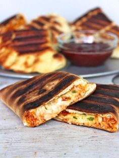 Maegan Brown from The BakerMama gets her grill on with these awesome grilled calzones that are filled with barbeque chicken and lots of melting cheese.