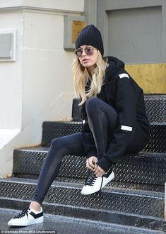 Serious gaze: The model also donned a knitted beanie with black and white sneakers for her solo outing in the Big Apple